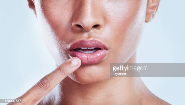 your lips need care too - lip balm stock pictures, royalty-free photos & images