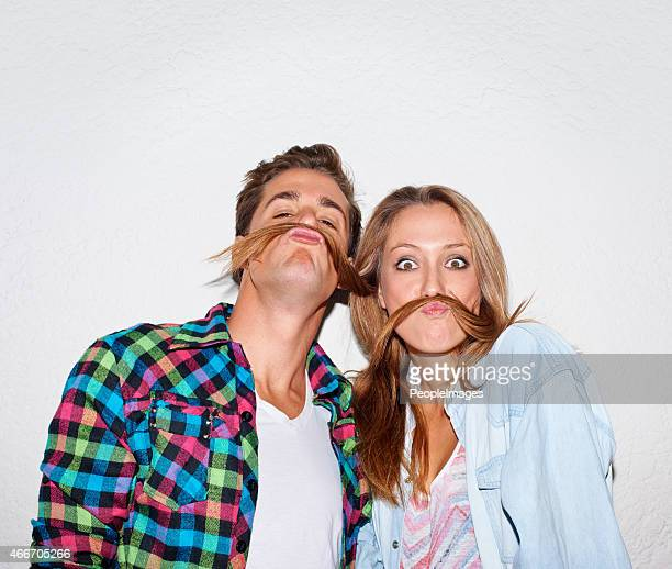 your moustache looks lovely... - freaky couples stock photos and pictures