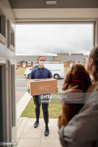 your package has arrived! - e commerce stock pictures, royalty-free photos & images