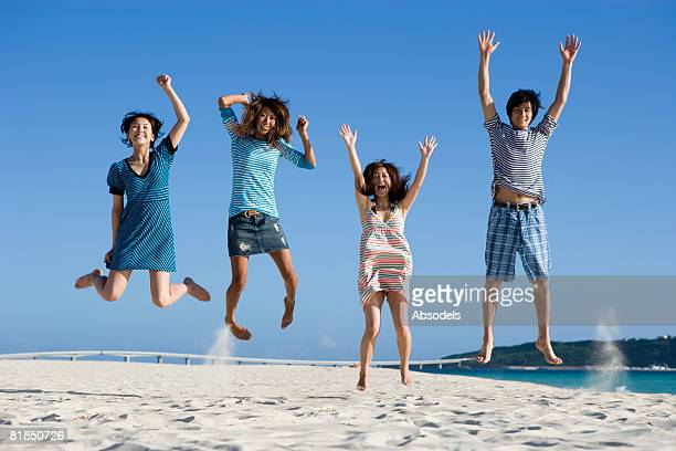 Your people jumping on beach