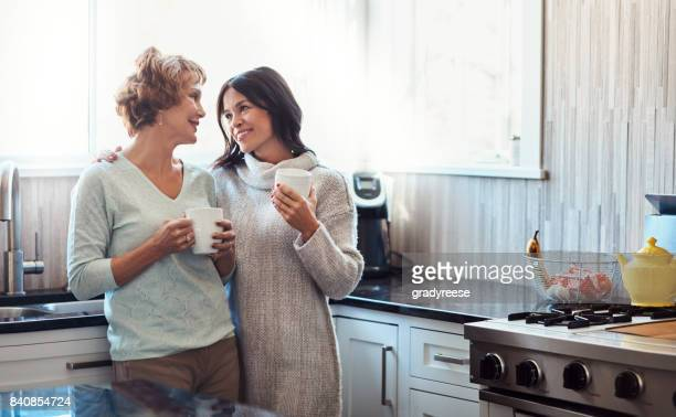 your visits mean so much to me, mom - mother daughter stock photos and pictures