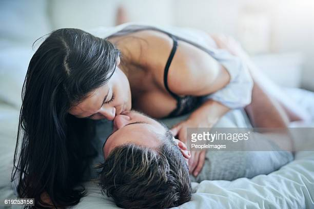 you're all i need - couple and kiss and bedroom stock photos and pictures