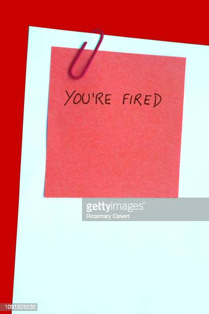 'you're fired',message on note attached to blank paper - being fired photos stock pictures, royalty-free photos & images