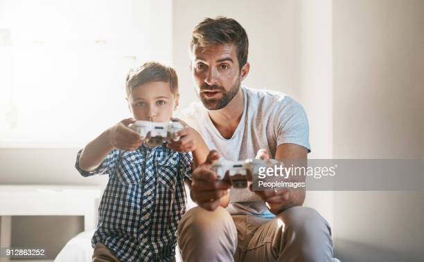 you're getting better than i am, son - leisure games stock pictures, royalty-free photos & images