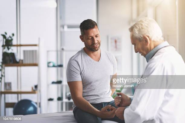 you're gonna feel a little prick - male doctor stock photos and pictures