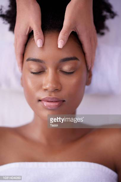 you're in the soothing hands of a professional now - head massage stock photos and pictures