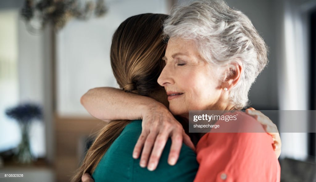 You're never too old to get a hug from mom : Stock Photo