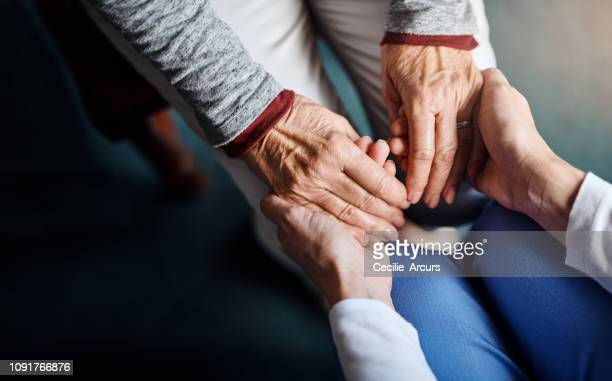 you're not alone in this - holding hands stock pictures, royalty-free photos & images