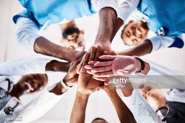 you're safe and secure in our hands - huddling stock pictures, royalty-free photos & images