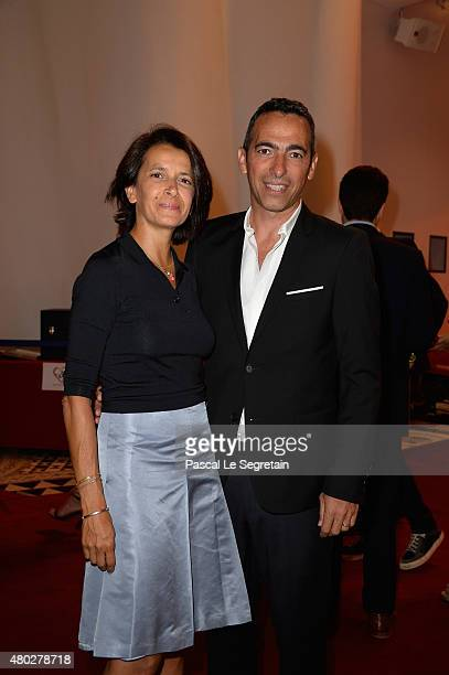 Youri Djorkaeff and his wife attend the Fight Aids Charity Gala In MonteCarlo on July 10 2015 in Monaco Monaco