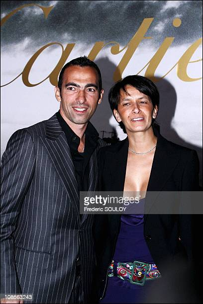 Youri Djorkaeff and wife in Paris France on April 07th 2004