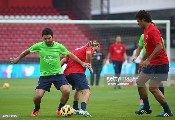 Youri Djorkaeff is challenged by Michel Salgado during a training session in the lead up to the the Global Legends Series at the SCG Stadium on...