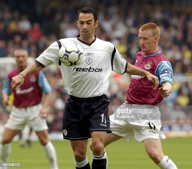 Youri Djorkaeff of Bolton Wanderers shields the ball from Steve Lomas of West Ham United during the FA Barclaycard Premiership match between West Ham...
