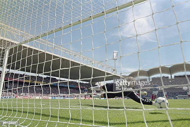 Youri Djorkaeff of France scores a penalty goal against a diving goalkeeper Peter Schmeichel of Denmarkduring the 1998 FIFA World Cup Group C match...