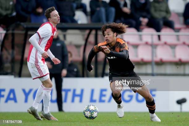 Youri Regeer of Ajax U19 Gaston Kappes of Valencia U19 during the match between Ajax U19 v Valencia U19 at the De Toekomst on December 10 2019 in...