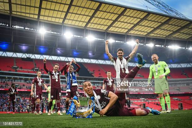 Youri Tielemans and Leicester City players celebrate with the Emirates FA Cup trophy following The Emirates FA Cup Final match between Chelsea and...