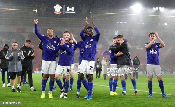 Youri Tielemans, James Maddison, Wilfred Ndidi, Marc Albrighton, Harvey Barnes and Ben Chilwell of Leicester City celebrate victory after the Premier...