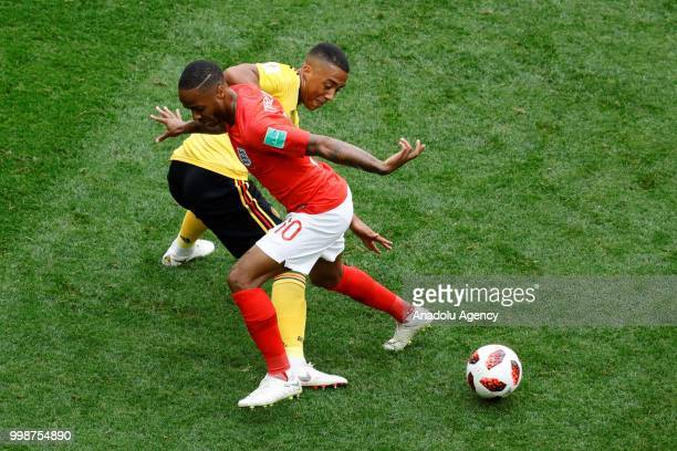 Youri Tielemans of Belgium and Raheem Sterling of England vie for the ball during the 2018 FIFA World Cup 3rd place match between Belgium and England...