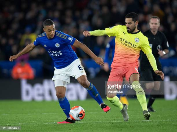 Youri Tielemans of Leicester City and Ilkay Gundogan in action during the Premier League match between Leicester City and Manchester City at The King...