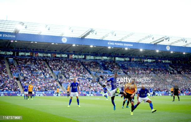 Youri Tielemans of Leicester City and Joao Moutinho of Wolverhampton Wanderers battle for the ball during the Premier League match between Leicester...