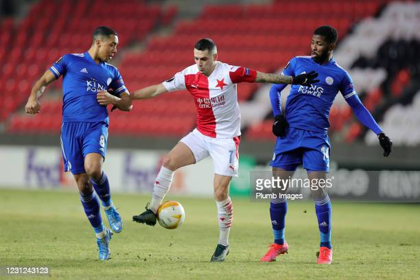 Youri Tielemans of Leicester City and Kelechi Iheanacho of Leicester City in action with Nicolae Stanciu of Slavia Prague during the UEFA Europa...