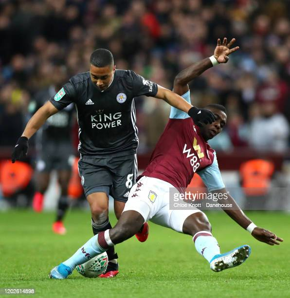 Youri Tielemans of Leicester City and Marvelous Nakamba of Aston Villa in action during the Carabao Cup Semi Final match between Aston Villa and...