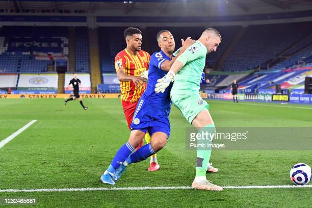 Youri Tielemans of Leicester City and Sam Johnstone of West Bromwich Albion during the Premier League match between Leicester City and West Bromwich...