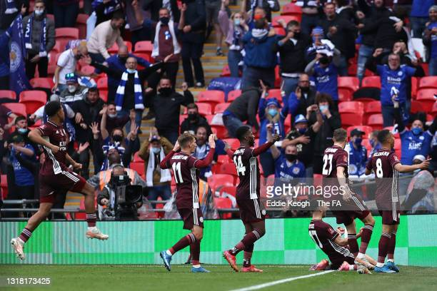 Youri Tielemans of Leicester City celebrates in front of the fans with team mates after scoring their side's first goal during The Emirates FA Cup...