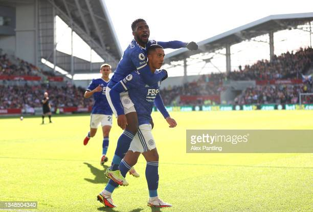 Youri Tielemans of Leicester City celebrates with team mate Kelechi Iheanacho after scoring their sides first goal during the Premier League match...