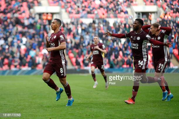 Youri Tielemans of Leicester City celebrates with team mates Kelechi Iheanacho and Marc Albrighton after scoring their side's first goal during The...
