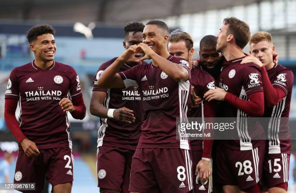 Youri Tielemans of Leicester City celebrates with teammates after scoring his sides fifth goal during the Premier League match between Manchester...