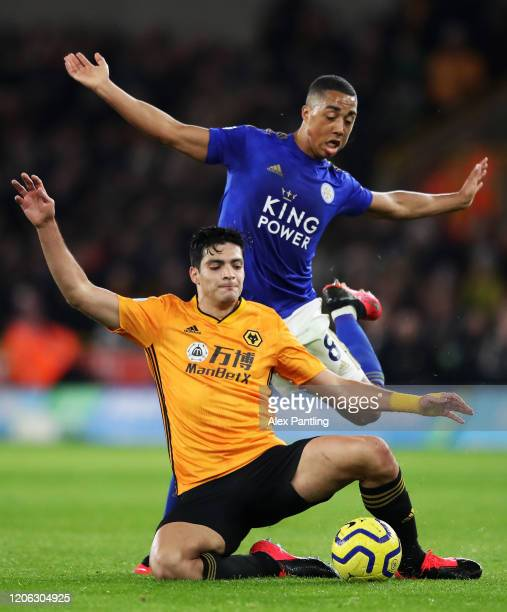 Youri Tielemans of Leicester City fouls Raul Jimenez of Wolverhampton Wanderers during the Premier League match between Wolverhampton Wanderers and...