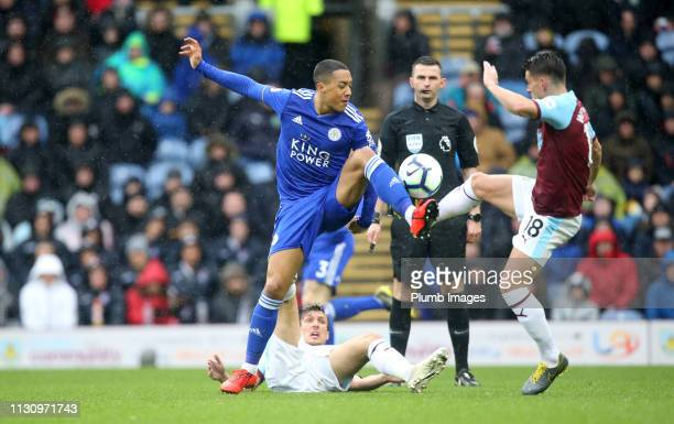 Youri Tielemans of Leicester City in action with Ashley Westwood of Burnley during the Premier League match between Burnley FC and Leicester City at...