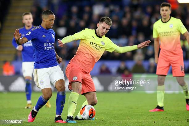 Youri Tielemans of Leicester City in action with Aymeric Laporte of Manchester City during the Premier League match between Leicester City and...