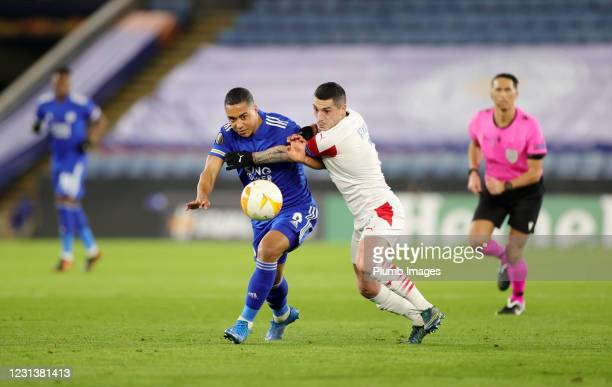 Youri Tielemans of Leicester City in action with Nicolae Stanciu of Slavia Prague during the UEFA Europa League Round of 32 match between Leicester...