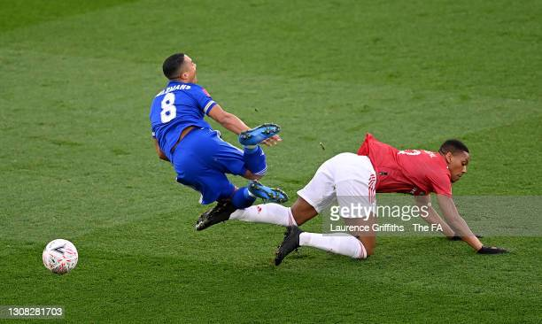 Youri Tielemans of Leicester City is challenged by Anthony Martial of Manchester United during the Emirates FA Cup Quarter Final match between...