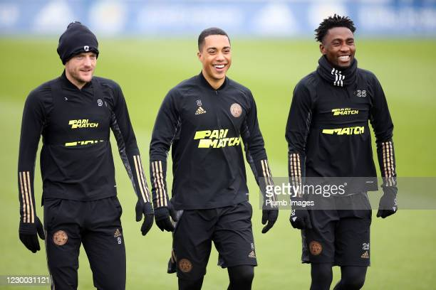 Youri Tielemans of Leicester City jokes with Jamie Vardy of Leicester City and Wilfred Ndidi of Leicester City during the Leicester City training...