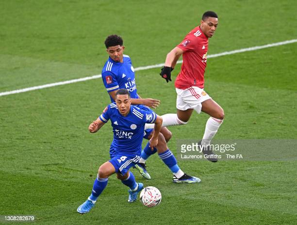 Youri Tielemans of Leicester City runs with the ball whilst under pressure from Anthony Martial of Manchester United during the Emirates FA Cup...