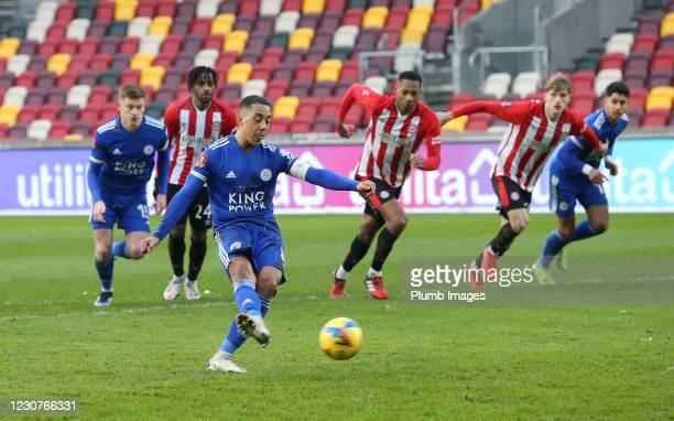 Youri Tielemans of Leicester City scores from the penalty spot to make it 1-2 during The Emirates FA Cup Fourth Round match between Brentford and...
