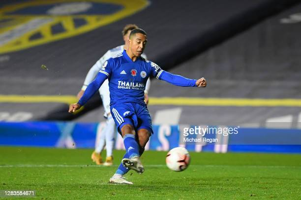Youri Tielemans of Leicester City scores his team's fourth goal from a penalty during the Premier League match between Leeds United and Leicester...