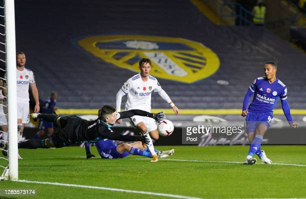 Youri Tielemans of Leicester City scores his team's second goal as Illan Meslier of Leeds United attempts to save during the Premier League match...