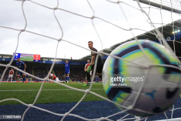 Youri Tielemans of Leicester City scores their 1st goal as Bernd Leno of Arsenal looks on during the Premier League match between Leicester City and...