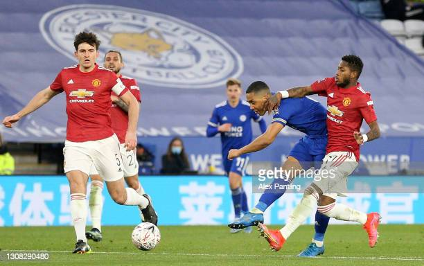 Youri Tielemans of Leicester City scores their side's second goal whilst under pressure from Fred of Manchester United during the Emirates FA Cup...