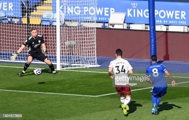 Youri Tielemans of Leicester City scores their team's first goal past Bernd Leno of Arsenal during the Premier League match between Leicester City...