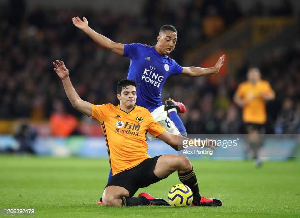 Youri Tielemans of Leicester City tackles Raul Jimenez of Wolverhampton Wanderers during the Premier League match between Wolverhampton Wanderers and...