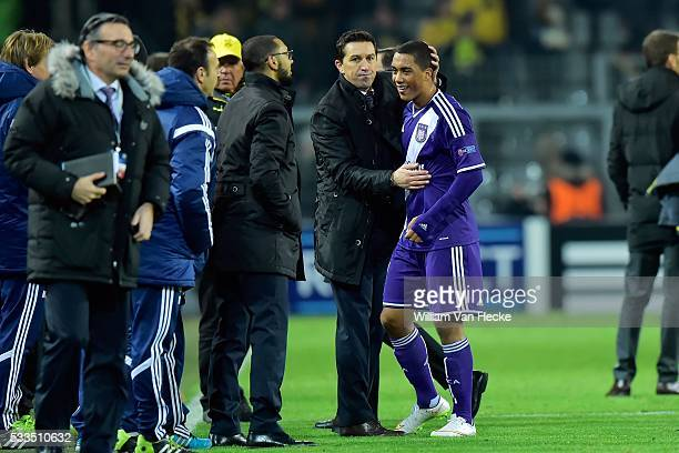 Youri Tielemans of RSC Anderlecht is congratulated by head coach Besnik Hasi of RSC Anderlecht after the UEFA Champions League Group D match between...