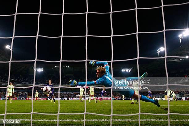 Youri Tielemans of RSC Anderlecht scores his team's third goal past Jonas Lossl of 1 FSV Mainz 05 during the UEFA Europa League Group C match between...