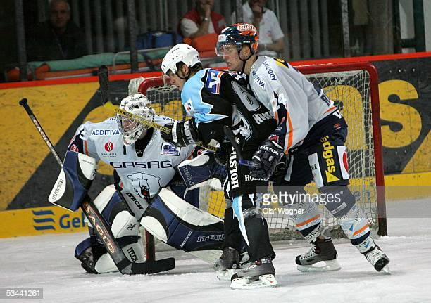 Youri Ziffzer Andre Rankel Christian Hommel in action during the friendly match between Eisbsren Berlin and Hamburg Freezers on August 19 2005 in...