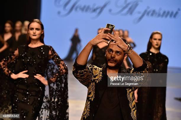 Yousef AlJasmi walks the runway after his show during Dubai Fashion Forward Spring/Summer 2016 at Madinat Jumeirah on October 23 2015 in Dubai United...