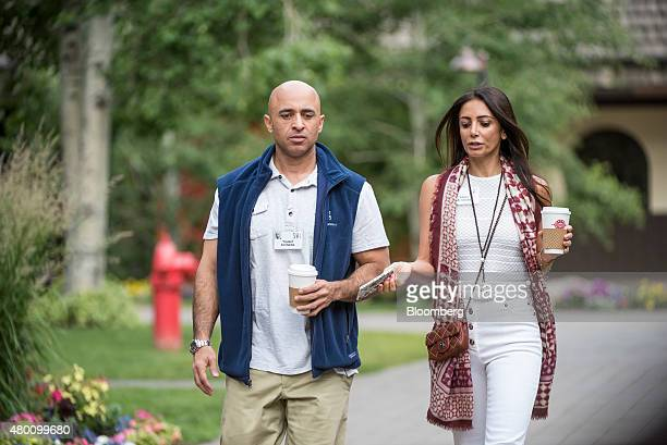 Yousef alOtaiba ambassador of the United Arab Emirates to the US and his wife Abeer Al Otaiba arrive for a morning session during the Allen Co Media...